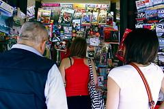 Voglio notizie buone (Roberto Arleo) Tags: people italy man rome roma girl italia libri edicola quotidiano giornali spalle edicolante