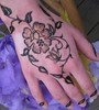 Henna Mehindi for Katy, a rose on her hand Volcano Blue Henna