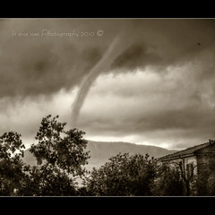 Tornado (in eva vae) Tags: trees wild sky blackandwhite bw italy panorama white house storm black water