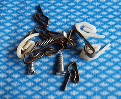 Assorted screws and picture and curtain hooks
