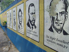 Jamaica's national heroes are painted on the school walls (bbcworldservice) Tags: world school girls boys field athletics downtown track stadium assignment champs christopher coke lord kingston national bbc jamaica drug service athletes 2010 dudus