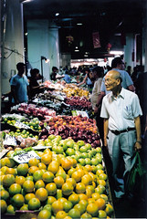 Fruit Buyer (johnno_oz) Tags: trip film fruit analog 35mm chinatown fuji market superia sydney australia olympus 400 fujifilm analogue haymarket 35 paddys trip35 fujicolor fujicolorsuperiaxtra400 auselite