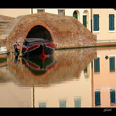 mirror (gicol) Tags: city bridge pink italy color reflection water beautiful boat canal fantastic agua eau barca italia dramatic rosa ciudad ponte reflet reflejo ferrara acqua calma canale barque citt romagna riflesso comacchio relaxe captivating srnit quitness serenit quitude leuropepittoresque
