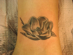 Friday's Magnolia (on Sarah) - teeny tiny, it's on her ankle  5/1 (wages) Tags: flower nashville shannon magnolia ankle wages blackandgray shannonwages