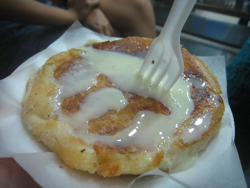 Arepa con queso (with cheese, topped with sweetened condensed milk) in Medellin.