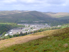 LOOKING OVER LANGHOLM.  01 (the water watcher 05.) Tags: trees summer sky brown white tree green nature water clouds rural landscape grey scotland landscapes countryside town woods stream skies village view heather hill gray farmland hills pasture views vista bracken summertime moor townscape rollinghills borders greysky windfarm moorland dumfriesandgalloway windturbines greyclouds countryscene esk greyskies dumfriesshire arable langholm riveresk ruralscene hilltops fujifinepixs5600 whita borderesk roughpasture whitahill winffarm themuckletoon meikleholmhill thelangholmwalks ruralvista dumfriesshirehills