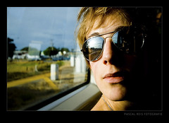 What's outside? Part II (Pascal Reis) Tags: woman girl face sunglasses train landscape gesicht fenster zug frau landschaft spiegelung sonnenbrille striplight seitenlicht