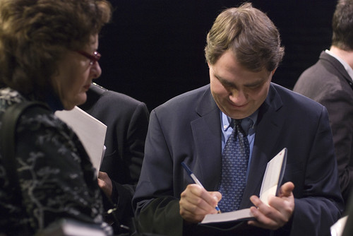 Michael Lux signs a book