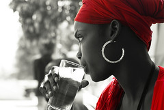 glass of water_Portrait (lilion) Tags: africa light red portrait girl beauty rouge bravo s afrika senegal dakar hl thisisart portraitp enprofile utatafeature fivestarsgallery mywinners flickrduel artlibre pentaxk10d lilion infinestyle copyrightedallrightsreserved jmeszolybeatrix beatrixjourdan