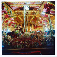 Carousel (Lady Vervaine) Tags: uk longexposure light england horse colour london 120 film night mediumformat carved holga colours fairground kodak britain toycamera carousel carving colourful magicroundabout funfair 160vc portra kodakportra160vc siouxsie 120n palabra portra160vc holga120n londonist kodakportra siouxsiethebanshees