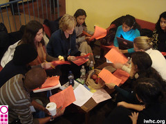 IWHC staff, colleagues, and youth activists confer