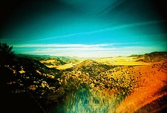 The Flickr Express (kevin dooley) Tags: blue arizona cactus sky mountain southwest green film analog train 35mm landscape iso100 lomo xpro lomography crossprocessed highway flickr slim desert sink time kodak wide perspective slide az busy too elitechrome viv vivitar e6 ultra freight moderation dilemma c41 ebx vuws vivalaviv
