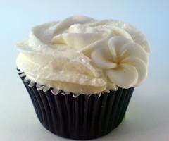 Chocolate cupcake with sparkles and a frangipani flower (Star Bakery (Liana)) Tags: sparkles chocolate vanilla swirl frangpani