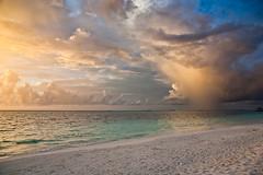 Between Storm and Sunset (Trantran!) Tags: blue light sunset sea summer sky sun storm art beach water clouds canon wow islands warm natural 5d maldives 2470l maldivian surnatural canoneos5d nothdr canonef2470f28lusm goldstaraward therebeastormabrewin vosplusbellesphotos