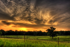 Starburst :: HDR (Jon.B.) Tags: trees sunset sky orange sun green field grass yellow rural photoshop sunrise canon fence landscape rebel midwest country explore pasture missouri barbedwire 1855mm ozarks hdr highdynamicrange stjames xsi cs4 3xp photomatix 450d