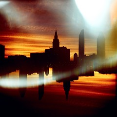 440 Sunset (roostercoupon) Tags: camera original light sunset ohio red orange color 120 film skyline analog vintage square toy holga lomo xpro exposure downtown cross mask kodak horizon cleveland slide down double explore tape flip multiple oh gaffer processed vignette e100gx 440 upside flares leaks 120s expored