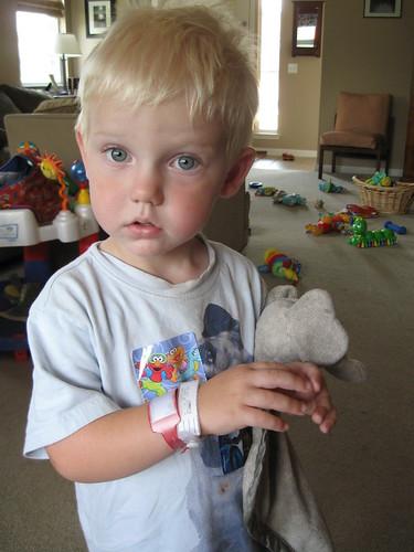 Modeling his bracelets