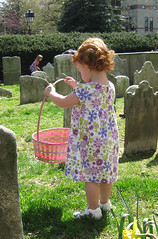 Speck with flowered dress and Easter basket, in church yard