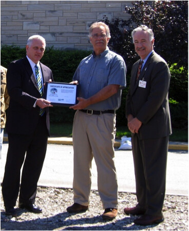 Jasper County Hospital officials receive a Certificate of Appreciation from USDA Rural Development Indiana State Director Phil Lehmkuhler (left).