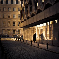 Last Living Souls (in the Corrupted City) (Gilderic Photography) Tags: street city light shadow brussels urban cinema man reflection building window silhouette wall architecture canon dark square eos europe raw mood darkness belgium belgique belgie bruxelles ombre story reflet lumiere cinematic rue mur brussel homme fenetre trottoir batiment lightroom carre 500d 500x500 obsur gilderic bestcapturesaoi