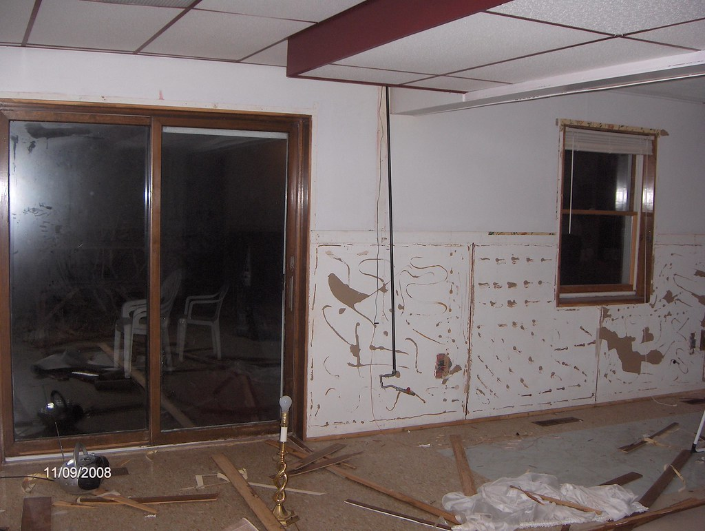 Paneling was removed South wall...also notice the exposed gas line that supplied gas to the wall heater for the room
