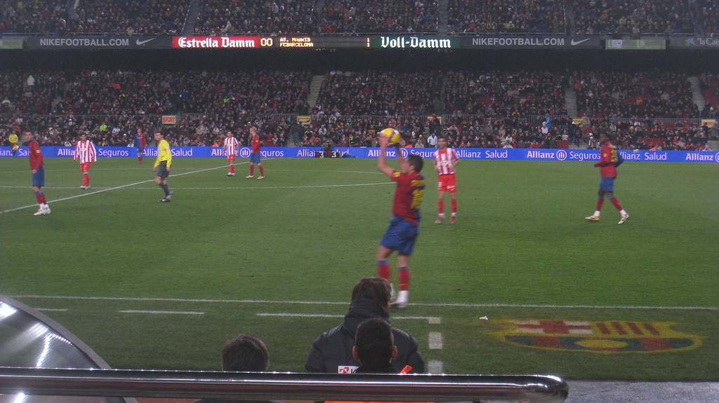 An FC Barcelona throw in. My seat was in the first row behind the VIP section and players' benches.