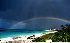 Rainbow Cemetery (Stephanie Wesolowski) Tags: ocean blue sea sky white seascape green beach water cemetery rain island seaside rainbow sand colorful aqua day cloudy turquoise horizon shoreline arc highcontrast overcast double full foliage clear highsaturation tropical thunderstorm sunlit bahamas reefs sansalvador