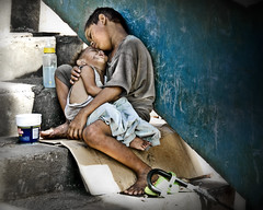 Street children of the Philippines (Mio Cade) Tags: poverty street charity boy baby love children kid hug toddler child market sister brother philippines homeless poor siblings beggar manila embrace 2009 begging abuse beg protect raise corruption fund baclaran blueribbonwinner riseup zarafa flickraward theunforgettablepictures earthasia superstarthebest onephotoweeklycontestwinner onephotoweeklycontestweek49