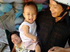 Pride and Joy (Grace's clicks) Tags: baby children cambodia grandmother joy siemreap fathers earthasia
