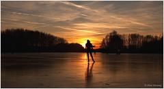 Linda skating in the Sunlight (Alex Verweij) Tags: winter sunset sunlight ice clouds canon zonsondergang skating daughter wolken almere schaatsen weerwater 40d aplusphoto overtheexcellence goldstaraward alexverweij lindaverweij