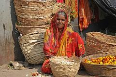 Phul Walli (Meanest Indian) Tags: poverty flowers people india women basket forsakenpeople mumbai saree maharastra marigold slum dadar wallah