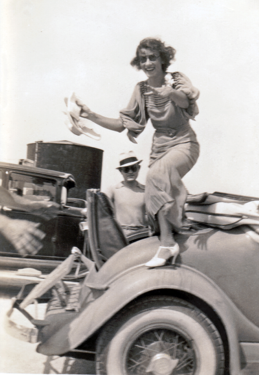 Woman exiting the rumble seat go back