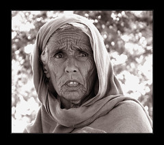 Lost (iz) Tags: travel pakistan portrait white tree green art face sadness women expression oldage cultural hairs taxila khanpur loat specialpicture