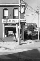 114 De Grassi St - 1 - September 1988 (collations) Tags: toronto ontario architecture blackwhite documentary vernacular cocacola streetscapes builtenvironment cornerstores conveniencestores degrassigrocery urbanfabric saladatea degrassist varietystores cokefishtailsigns