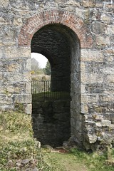 Arch detail on Baronets engine house. (john durrant) Tags: uk chimney brick cornwall arches stack granite coppermine tinmine redruth kernow quoins whealamelia pennanceconsols carnmarth baronetsenginehouse