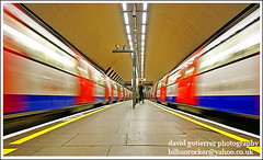 London Underground in Double Vision ...;-} (david gutierrez [ www.davidgutierrez.co.uk ]) Tags: life city light urban london colors architecture train underground spectacular geotagged photo moving interestingness arquitectura cityscape image metro sony centre tube perspective platform cities cityscapes center front double explore 350 page londres sensational metropolis londonunderground alpha topf100 frontpage clapham londra claphamcommon impressive dt mindthegap doublevision municipality cites perfecttiming f4556 100faves aupaathletic 1118mm sonyalpha thanksyou claphamcommontubestation platinumheartaward sonyalphadslra350 inspiredbyyourbeauty sonyalphadslr350 sonyalphadt1118mmf4556lens doublevisioninthe sonyalphadt1118mmf4556 sony350dslra350 wwwdavidgutierrezcouk