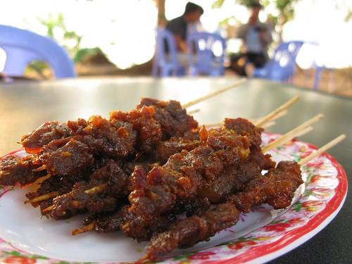 Riverside street eats, grilled pork skewers - Krati, Cambodia