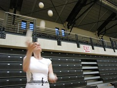 Viveca Gardiner, New York City juggler and combat referee, cascades five balls on Friday evening.
