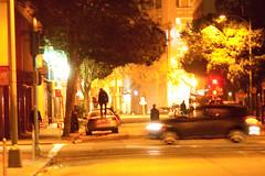 Person Standing on Car, Oakland Riots (Thomas Hawk) Tags: california usa america oakland riot unitedstates unitedstatesofamerica protest bart eastbay riots downtownoakland bartpolice oscargrant oaklandriot oaklandriot2009 oaklandriots2009 oscargrantriots oaklandriots