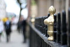 partially gold fence ... (_nejire_) Tags: england people black london businessman canon fence eos gold kiss bokeh f14 explore railing carlzeiss 945pm 30faves 10faves 25faves nejire 400d eos400d canoneos400d kissx fave10 fave30 mhashi fave25 carlzeissplanart1450ze