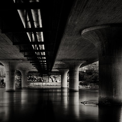 Under the bridge (crsan) Tags: bridge bw white lake black water canon long exposure sweden under smooth explore l 1740mm hoya nyköping lightroom 500x500 50d ndx8 nyköpingsån crsan holmér christianholmercom