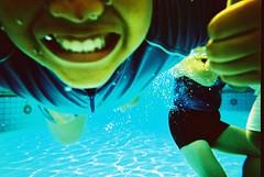 aqua smile (Jay Panelomo) Tags: people film water pool smile kids analog swimming swim lomo xpro lomography underwater kodak ripple crossprocess goggles slide analogue elitechrome ned northvale ebx snapsights panelomo jaypanelo jetpacmagazine002