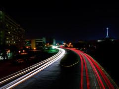 Bluebonnet Blvd. (Bruce Bordelon) Tags: road light motion cars church night rouge nikon louisiana boulevard cityscape cross jimmy bluebonnet d200 streaks f28 baton ihavesinned 1424mm swaggert ihavebeencaught
