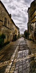 Rue Notre Dame (MarkEllis) Tags: road street panorama cloud house distortion france building wet rain overcast dordogne panoramic cobbles monpazier ruenotredame