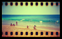 Sandy Beach Hawaii Holga 35mm (Justin Ornellas) Tags: ocean justin art film beach water 35mm vintage hawaii holga interestingness interesting lomo lomography waves surfing holes retro flip  hawaiian sandys sandybeach sprocket halona explored  ornellas ornellaswouldgo