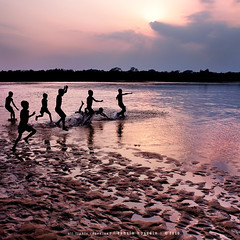 just another day! =) (Tahsin Hossain) Tags: life sunset cloud sun color reflection texture water beauty rural river children fun kid jump sand nikon bath colorful play natural lifestyle run 18200 bangladesh d90 netrokona birishiri