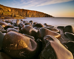 Cullernose Point, Northumberland (Corica) Tags: uk longexposure greatbritain england water sunrise nikon rocks erosion boulders northumberland northsea gb basalt howick craster d300 dolerite corica cullernosepoint swineden