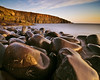 Cullernose Point, Northumberland (Corica) Tags: uk longexposure greatbritain england water sunrise nikon rocks erosion boulders northumberland northsea gb basalt howick craster d300 dolerite corica cullernosepoint swineden