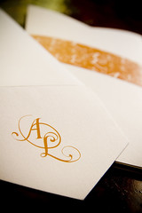 A shot of a close invitation with an envelope (Alistair & Liam) Tags: gay wedding orange motif guests groom al candle memories liam exquisite alistair throne invites invitations weddinginvitations initials gaywedding orangecandle booklets weddinginvites allogo oricha alistairliam almotiff 2grooms almotif motifsash