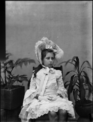 Portrait of young, bare legged girl, seated on wooden chair (Powerhouse Museum Collection) Tags: portrait plants white fern glass girl hat lady studio ruffles wooden chair child dress lace victorian young plate negative gloves bow fancy bonnet powerhousemuseum proper dignified portraitofalady decorum xmlns:dc=httppurlorgdcelements11 dc:identifier=httpwwwpowerhousemuseumcomcollectiondatabaseirn386438